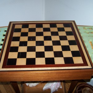 Ebony and Curly Maple chess board with matching chess pieces. trimmed in bloodwood.
