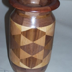 Walnut vase constructed out of triangles
