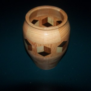 Segmented Wood turning. Honey Locust vase with 3D highlight ring of tumbling block design.