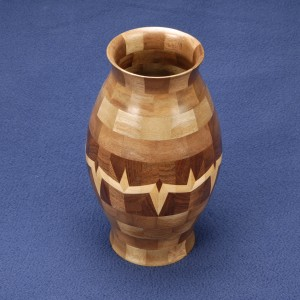 Multi generational segmented wood turning. Walnut vase with maple, 3 generation lamination design.