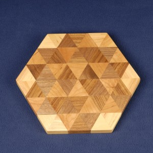 Triangles of teak, cherry, birch and walnut form this cutting board.