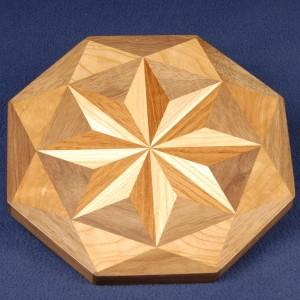 Pin wheels are a favorite. This ash and Brazilian cherry is framed with triangles of walnut and cherry.