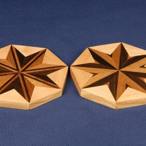 Trivets of unique 1st generation design of Brazilian walnut and cherry bordered with honey locust.