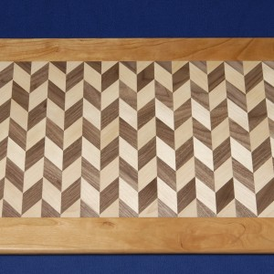This 2 generation walnut and birch platter is framed in cherry.