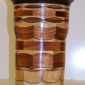 Segmented Wood turning, this unique vase is of ebony , mahogany and maple.