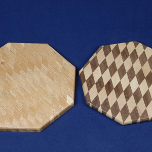 These 2 cheese boards demonstrate the use of contrast and the lack thereof to gain a desired look.