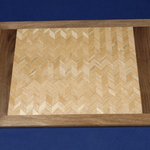 The lighter shades of cherry and oak blend together in less contrast highlighting the grain of this tray.