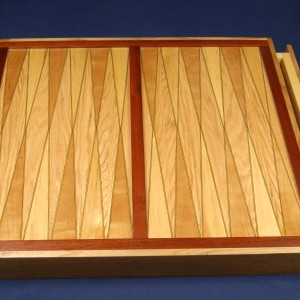 This 24 by 24 inch backgammon board is easier than it looks. Includes drawers.