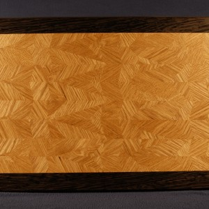 This multi generation 45/60A60AD is of white oak, with a wenge boarder. The piece accents the grain and needs on contrast in color to show off the intricate designs and patterns. A spline was used to affix the boarder.