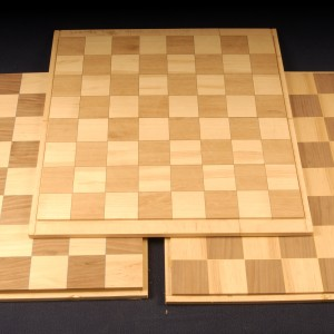 Chess blanks of ash, walnut and mahogany are mounted to a substrate and ready for application in your project.