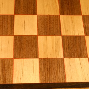 Birch and Walnut chess board with Red highlights
